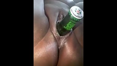 Tikas pussy swallows a full bottle of beer