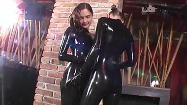 latex girls teasing